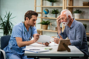 man consulting doctor at outpatient drug rehab center