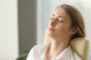 Woman undergoing eye movement desensitization and reprocessing therapy