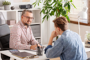 Therapist explaining a motivational interviewing program to his client