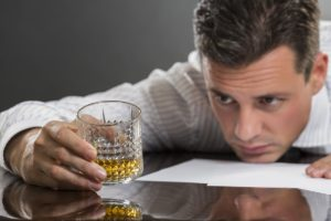 Man dealing with the issues of alcohol abuse