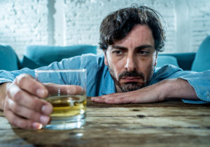 man struggles with alcohol and wonders is alcoholism a disease