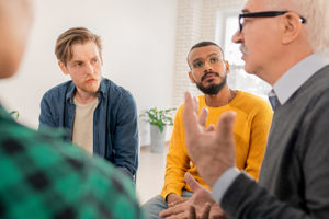man talking in group therapy at men's rehab center program in NH