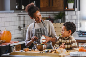 woman cooking sober Thanksgiving dinner with her son