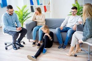 family therapy program new hampshire, family sits around couch and chairs looking dejected